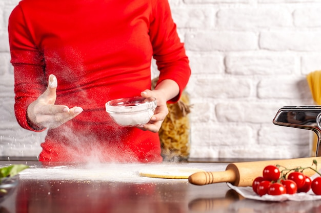 Manual process of making italian pasta fettuccine.