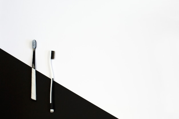 Manual toothbrush set on white and black background.