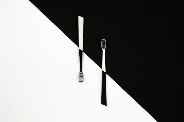 Manual toothbrush set on white and black