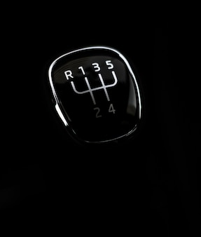 Manual transmission gear shift, on dark background