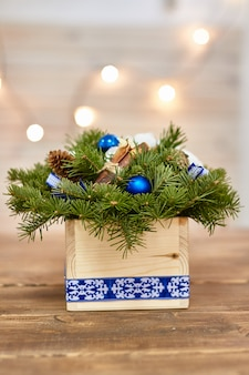 Manufacturer of christmas decor with their own hands. christmas box with twigs for the holiday