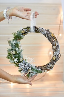 Manufacturer of christmas decor with their own hands. christmas wreath for the holiday