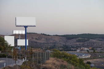 Many advertising billboards on highway