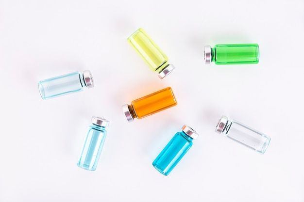 Many ampoules of different colors. medicine concept. background. copy space.