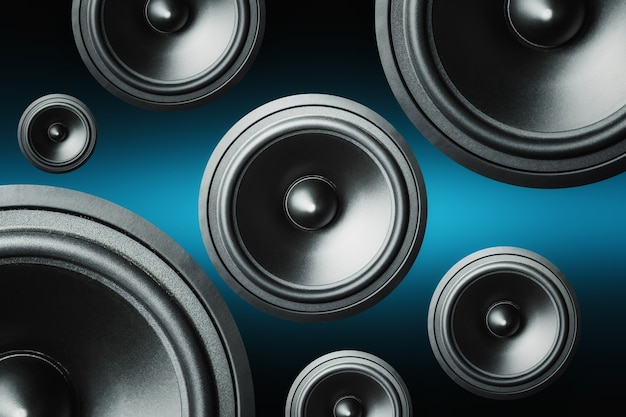 Many audio speakers on dark background