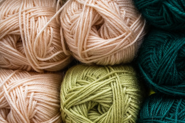 Many balls of wool yarn for knitting. selling fluffy threads in a craft store.