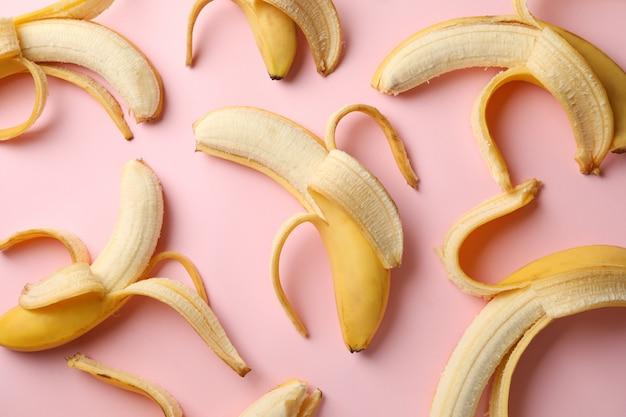 Many bananas on pink table. fresh fruit