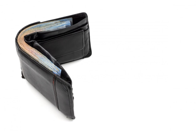 Many banknotes in black wallet on white background. copy space