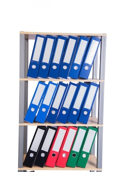 Many binder folders on the shelf