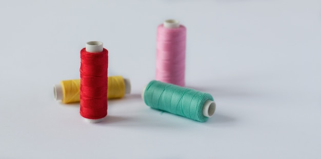 Many bobbins of bright  sewing  thread