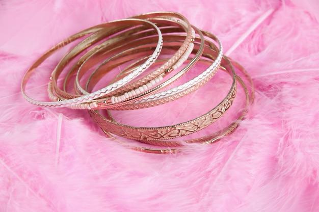 Many bracelets on pink