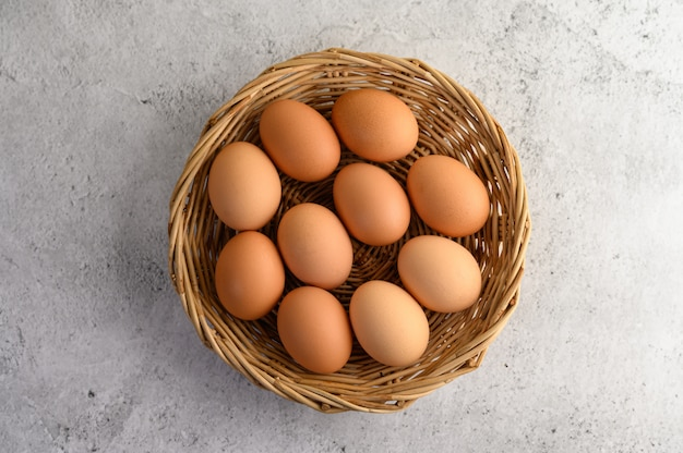Many brown eggs several in a wicker basket