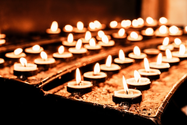Many burning candles with shallow