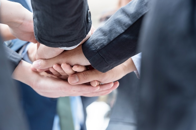 Many business people join hands together for the first agreement to do business together
