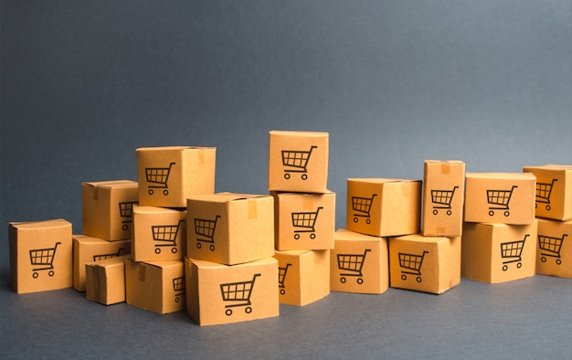 Many cardboard boxeswith drawing of shopping carts. products, goods