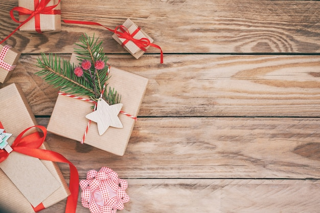 Many christmas gift boxes on wooden background.