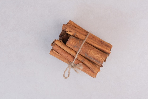 Many of cinnamon sticks on white