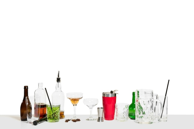 The many cocktails on the bar counter isolated on white table