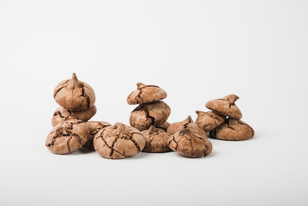 Many cocoa cookies isolated on white backdrop