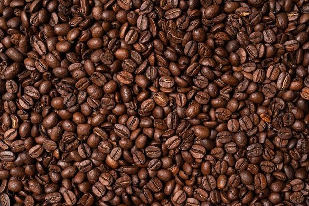 Многие кофейные зерна фоновой текстуры