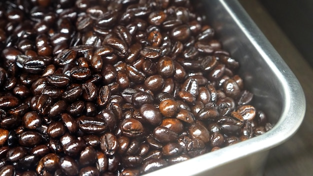 Many coffee beans from excellent source around the world in silver metal tray which special handmade