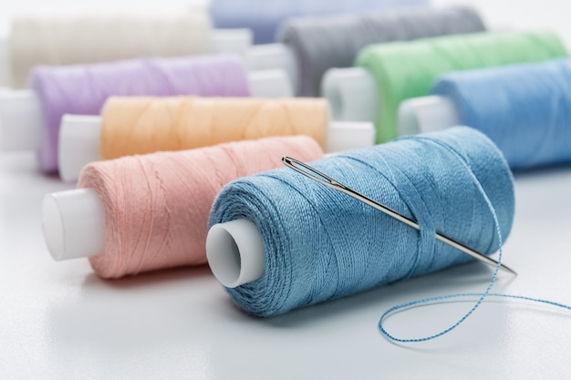 Many coils with threads of pastel tones.