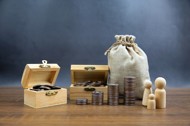 Many coins are stacked in a graph shape and many coins in a wooden crate.