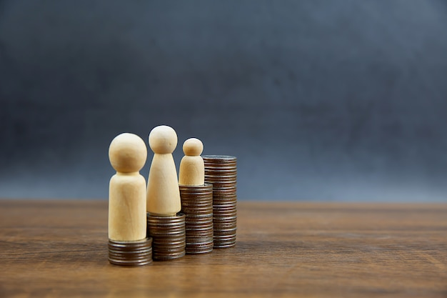 Many coins are stacked in a graph shape with family for money saving ideas financial planning and insurance.
