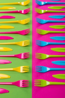 Many color plastic cutlers on a bright background