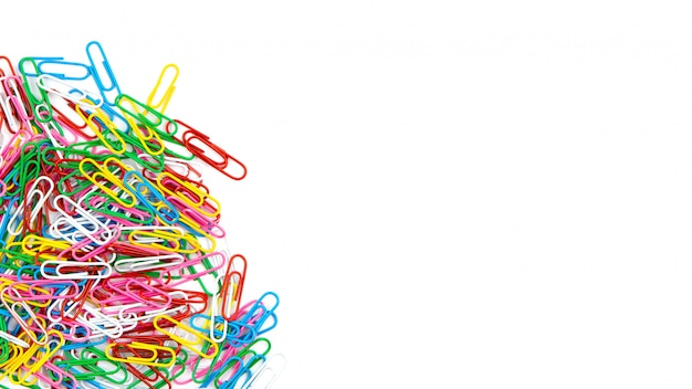 Many color stationery paper clips on a white background. top view and copy space