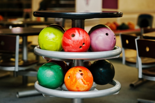 Many colored balls for bowling at table to store