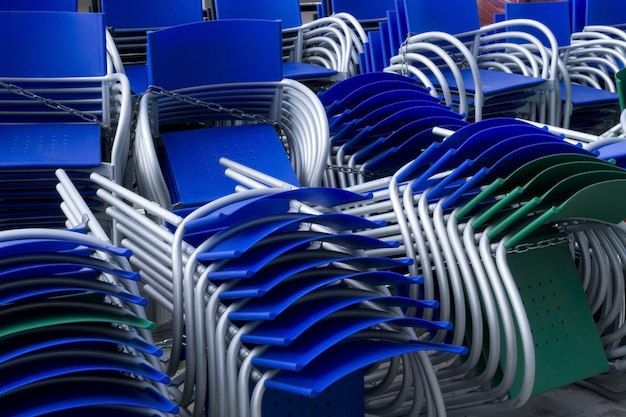 Many colored piled chairs outdoor