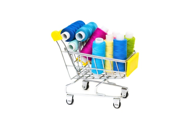 Many colored threads in a shopping cart on a white background.