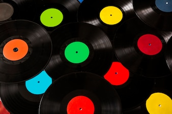 Many colorful and black vinyl records