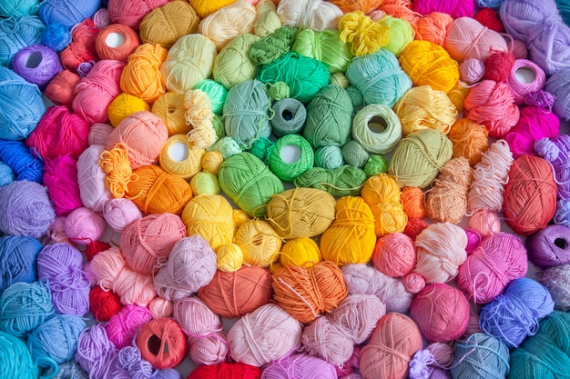 Many colorful balls of wool and cotton yarns