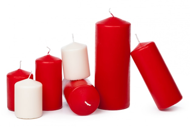 Many colorful candles isolated on white