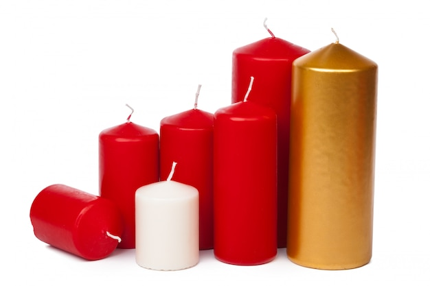 Many colorful candles  on white background