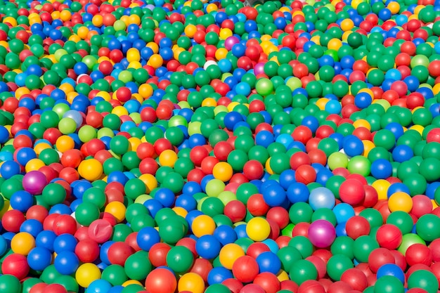 Many colorful children's plastic balls of small size