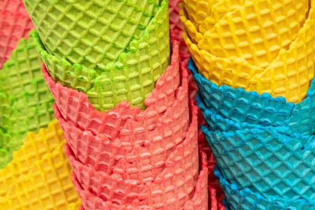 Many colorful crispy waffer cones for ice cream