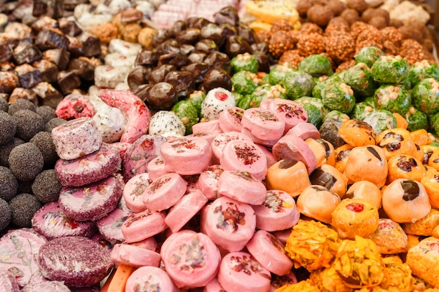 Many colorful delicious sweet candies close-ups at a children's party