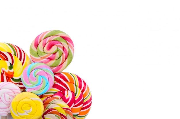 Many colorful lollipops isolated on white background. studio shot