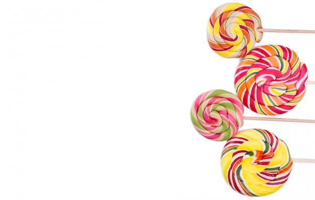 Many colorful lollipops isolated on white background.