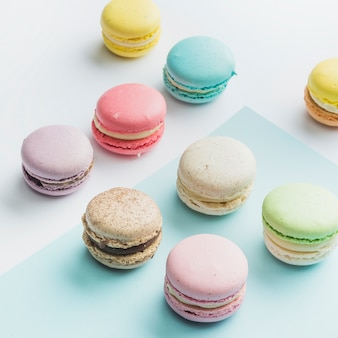 Many colorful macaroons on dual backdrop