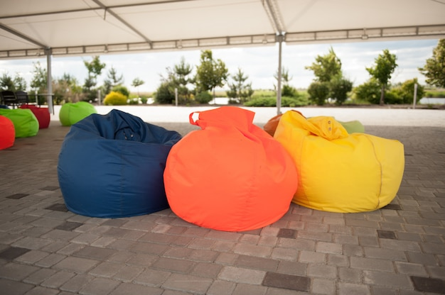 Many colorful soft beanbag seats