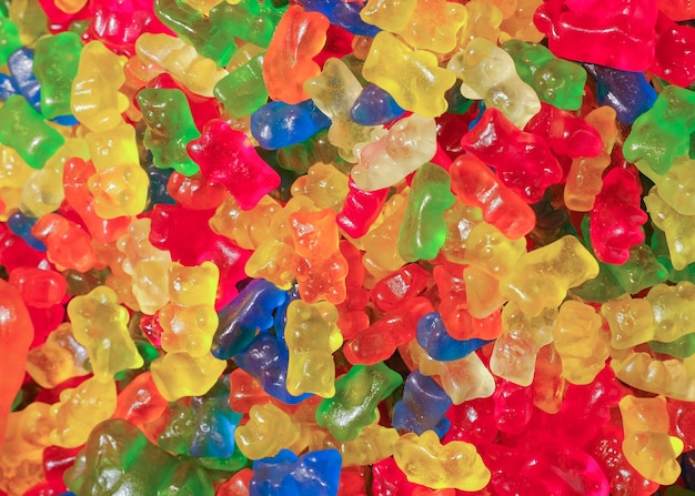 Many colorful tasty gummy bears candies. sweets background.