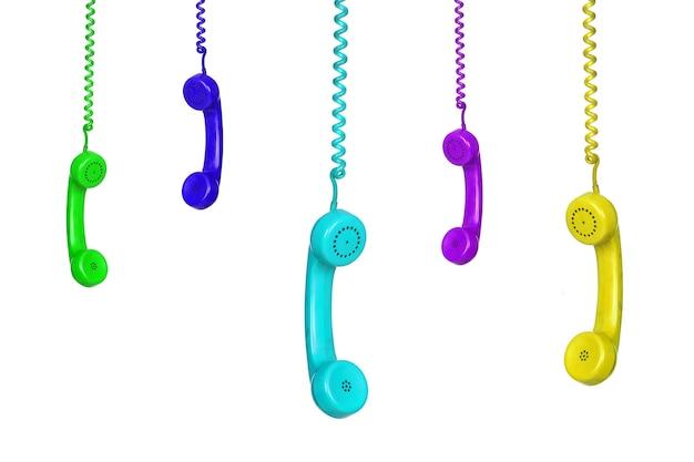 많은 다채로운 빈티지 전화 흰색 배경에 고립 매달려