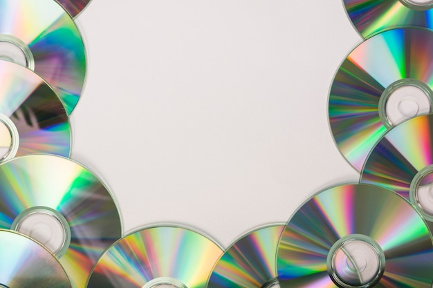 Many compact discs with space for text on white background