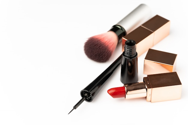 Many cosmetics for makeup and beauty of women on white background.