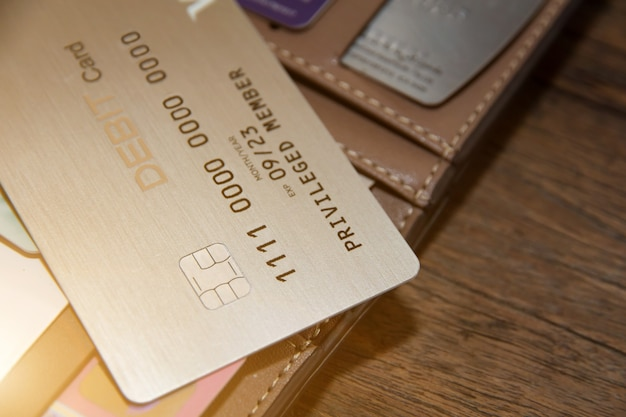 Many credit cards or debit cards on wooden, master card