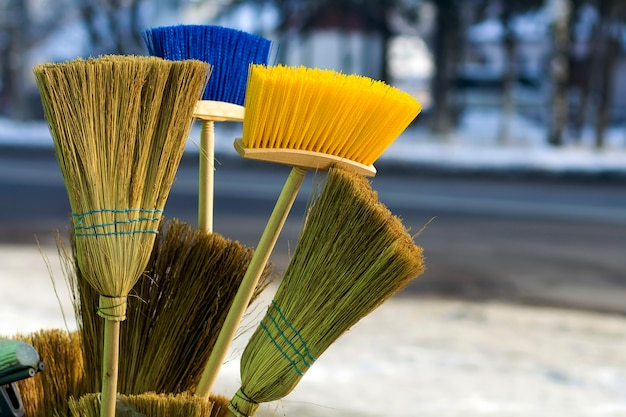 Many different brooms and floor brushes for sale